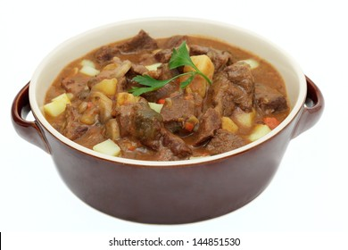 Goulash in a pot on white background