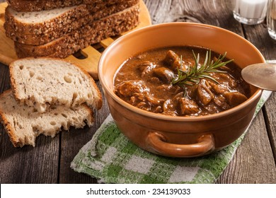 Goulash soup with pork and mushrooms.