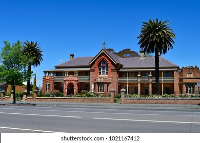 GOULBORN, NSW, AUSTRALIA - NOVEMBER 01: Old building besides Saints Peter and Paul's Old Cathedral in the tiny village in New South Wales, on November 01, 2017 in Golbourn, Australia