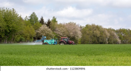 GOULT, NORMANDY, FRANCE - APRIL 24, 2018: A farmer spraying his crops.