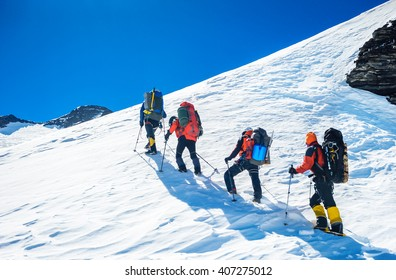 Goup of climbers reaching the simmit. Team work concept