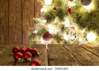 Goup of colorful Christmas baubles on wooden table. Christmas decorations on wooden surface.