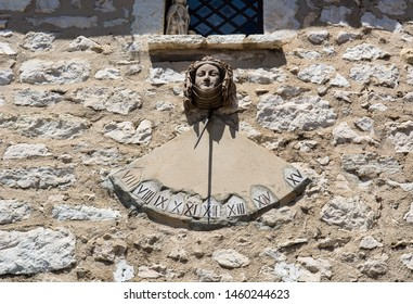 Gourdon, France, May 24th, 206 - Sundial on building in historic village in Gourdon, France.