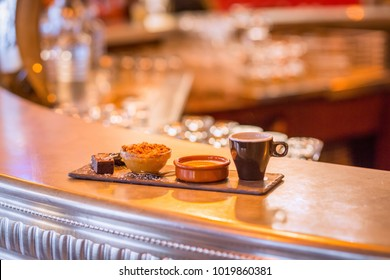 café gourmand coffe and desserts on french bistro bar in paris