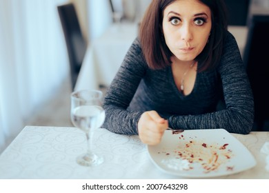 Gourmand Woman Eating Everything on a Plate. Funny girl overindulging herself having dessert in a restaurant