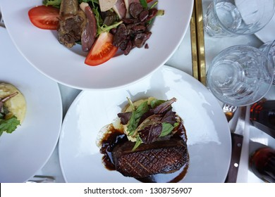 Gourmande Salad(Mesclun foie gras salad and gizzard) served with Roasted duck with Balsamic sauce
