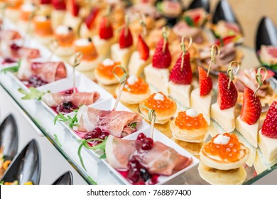 Gourmet appetizers: caviar, venison, tuna and salmon.