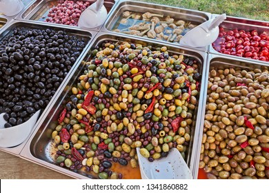 gourmet assortment of pickled olives and other vegetables preserved in brine in italian delicatessen market