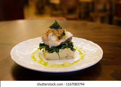 Gourmet Baked Codfish Set On a White Plate