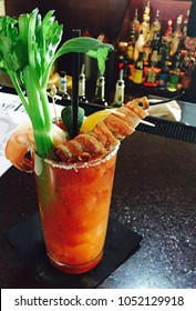 Gourmet Bloody Mary Cocktail with Bacon Wrapped Shrimp and Celery