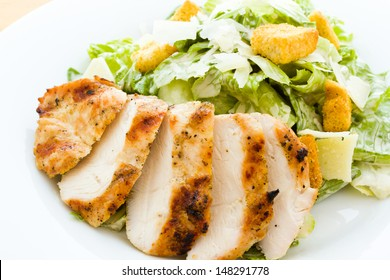 Gourmet caesar salad with grilled chicken croutons.