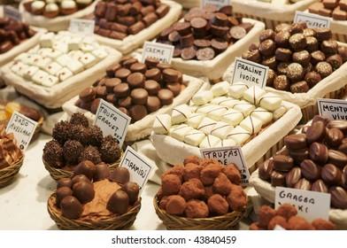 Gourmet chocolates on stall at Boqueria farmers market in Barcelona, Catalonia, Spain