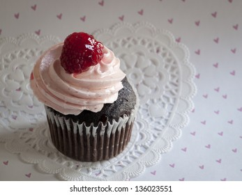 Gourmet cupcake on color backround.