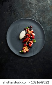 Gourmet dessert with cream and vanilla ice cream, bicuits and berries