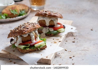 Gourmet Fish seafood burger with mayo and fresh vegetables