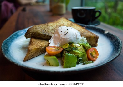 Gourmet French Toast with avocado at a Singapore Cafe