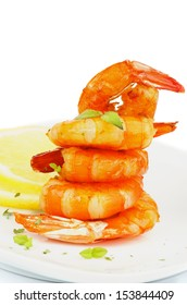 Gourmet Fried Shrimps Garnished with Lemon, Mustard Sauce and Thyme closeup on White plate