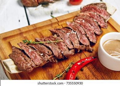 Gourmet Grill Restaurant Beef Steak Menu - Skirt Steak on Wooden Plate. Black Angus Beef Steak. Beef Steak Dinner
