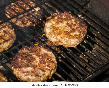 Gourmet hamburger parries on the grill.