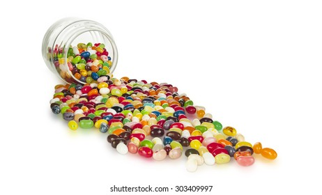 gourmet jelly beans spilling out of a glass candy jar