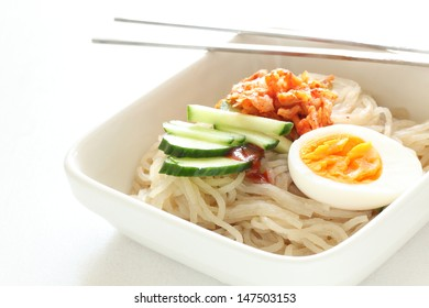Gourmet Korean cuisine,  cold noodles with egg and Kimichi on top for gourmet lunch menu