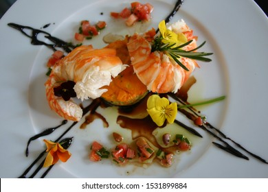 gourmet lobster tail plate with edible flowers