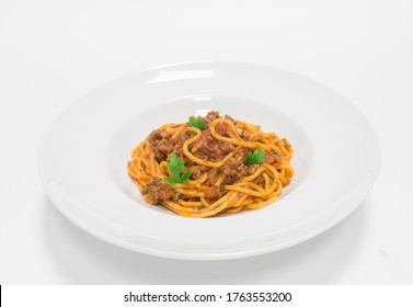 Gourmet pasta with minced meat and tomato sauce. Top view. White background. Healthy eating concept. Mixed media
