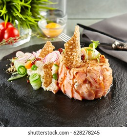 Gourmet Restaurant Food - Delicious Smoked Salmon and Vegetable Salad. Luxury Appetizer Restaurant Food