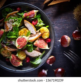 Gourmet roast pheasant, fig and chestnut salad with fresh basil or baby spinach in a cropped overhead view in square format