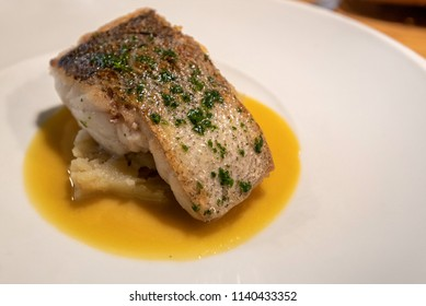 Gourmet serving of cod fish in a restaurant
