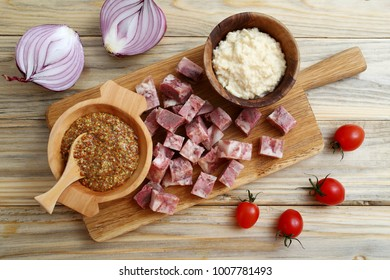 Gourmet set with prosciutto, pepperoni, salami slices on kitchen table background