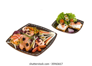 Gourmet smoked salmon dish and toast, garnished with shrimp, caviar, anchovies, olives and vegetables.  Studio shot.