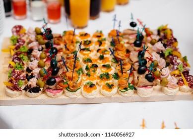 Gourmet snacks at a banquet. Wedding.