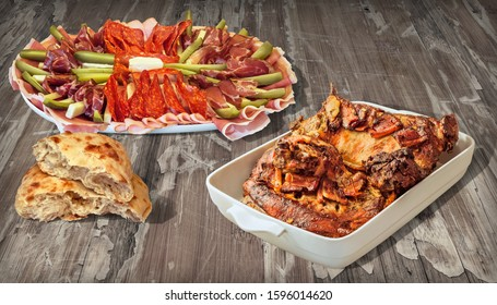 Gourmet Spit Roasted Lamb Meat and Traditional Appetizer Savory Dish with Fresh Pita Flatbread Loaf Set on Old Weathered Cracked Pinewood