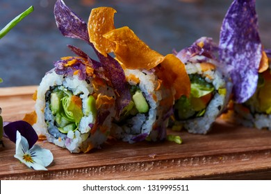 Gourmet sushi with avocado, lettuce, cucumber and tuna