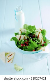 Gourmet Tasty Fresh Green Salad with Milk on White Wooden Table