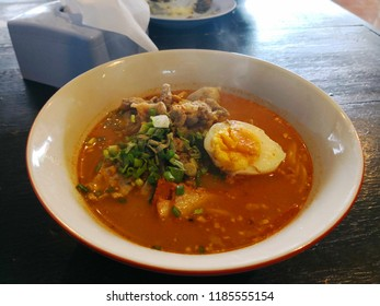 gourmet Tomyum spicy noodle with pork and egg.