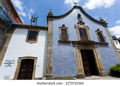 GOUVEIA, PORTUGAL – July 19, 2018:  Facade of the Baroque Church of Mercy built in the 18th century and the adjacent Holy House of Mercy  Translation: Holy House of Mercy of Gouveia