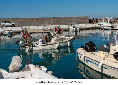 Gouves, Crete, Greece. October 2019.  Small cabin cruiser underway from the small harbour at Kato Gouves a former US military base