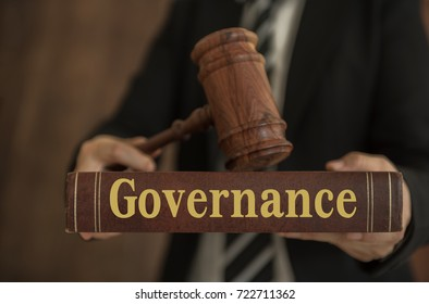 governance concept. business people holding governance books with a judge law.