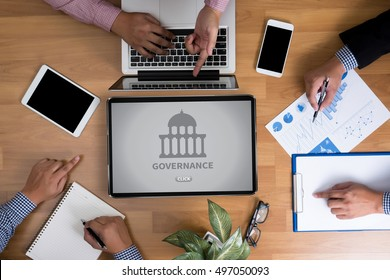 GOVERNANCE and Government building, Authority Government  Business team hands at work with financial reports and a laptop, top view