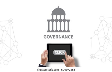 GOVERNANCE and Government building, Authority Government , on the tablet pc screen held by businessman hands - online, top view