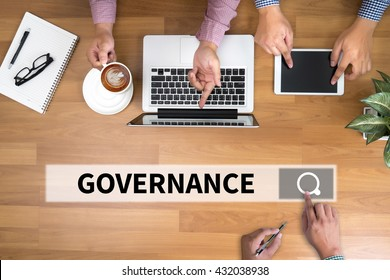 GOVERNANCE man touch bar search and Two Businessman working at office desk and using a digital touch screen tablet and use computer, top view