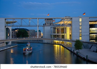 The government area in Berlin, in the background the Reichstag. In front the Spree river with one of the many sightseeing boats.