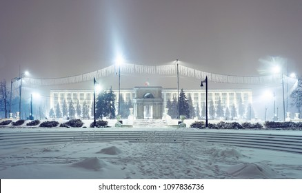Government building and arc of triumph with snow at night in Chisinau, Moldova