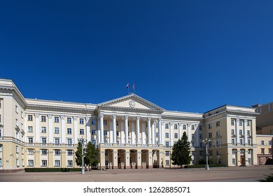 the government building was built in a classic strict style with white walls and columns, which sit important officials and the authorities of the city and the country adopted laws