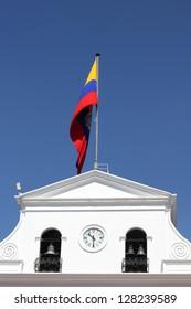 Government building and waving flag of Ecuador in Quito, Ecuador