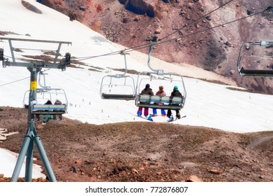 Government Camp, Oregon, USA -  August 17, 2010:  Snowboarders and skiers ride the lift at Timberline Lodge to do some summertime skiing and boarding.