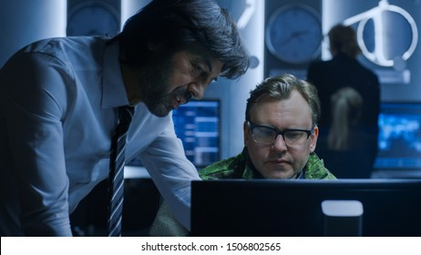 Government Chief of Cyber Security Agent Consults Military Officer who Works on Computer. Specialists Working on Computers in System Control Room.