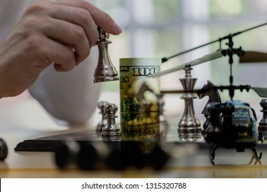 Government Military Defence Technology Abstract Background, Helicopter With Roll of US dollar Banknote, Concepts Of Modern Military Operation Cost.